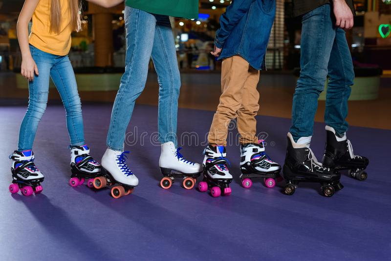 partial view of parents and kids skating on roller royalty free stock images