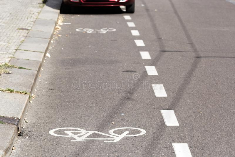 Partial view of a parked car on a bike path.  stock images