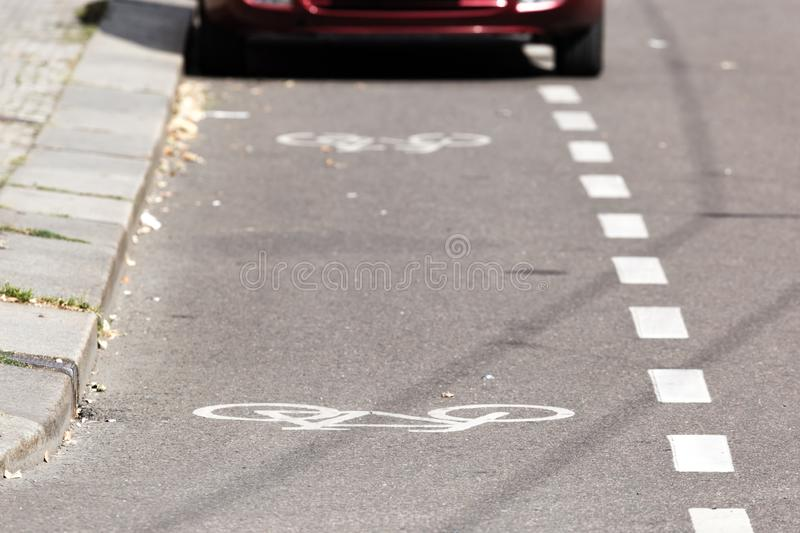 Partial view of a parked car on a bike path. Parked car on a bike path stock image