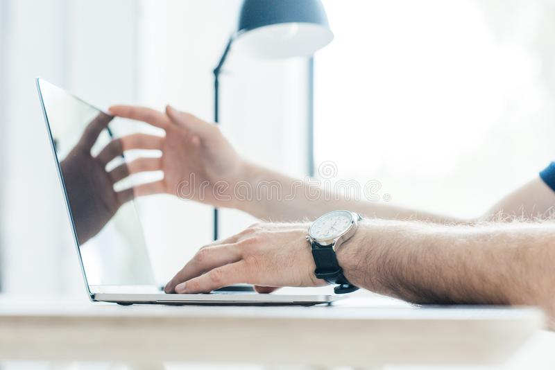 Partial view of person using laptop. At workplace royalty free stock images