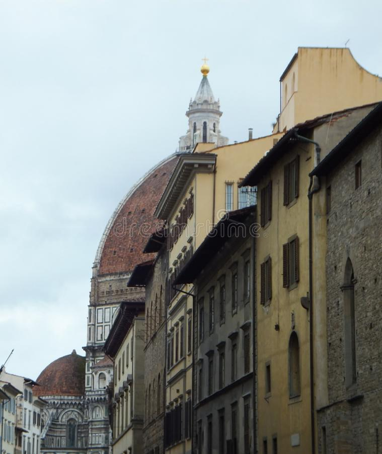 Partial view of Santa Maria del Fiore in Florence, hidden behind houses. Cloudy, damp weather royalty free stock photography