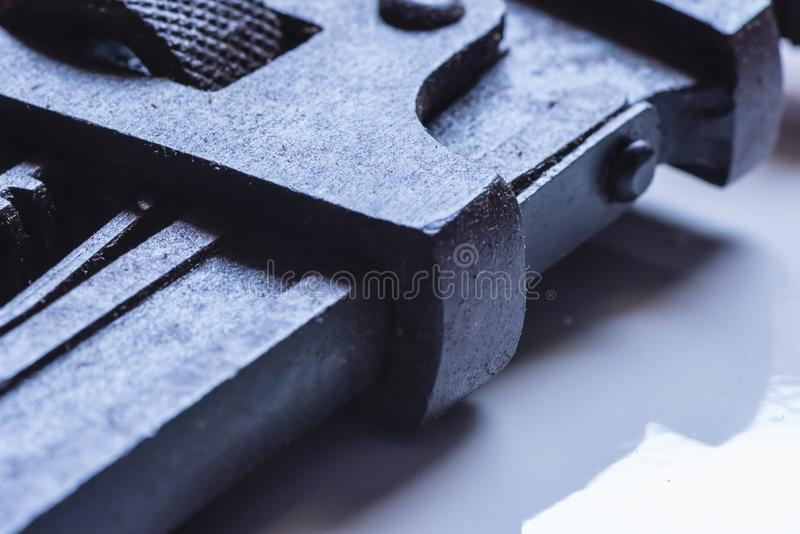Partial view of Stained Pipe Wrench. Hand tool in black greasy color royalty free stock images