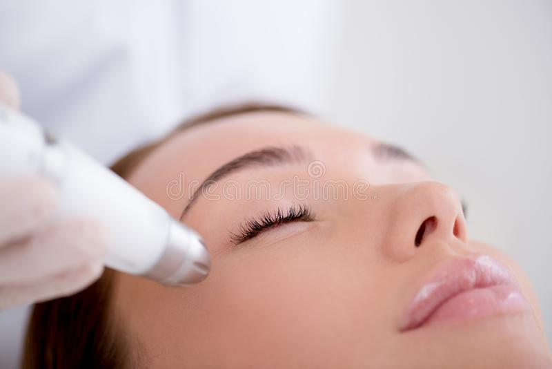 Partial view of woman getting facial treatment. In cosmetology salon stock photo