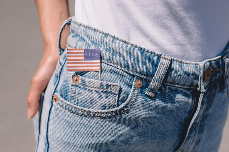 Partial view of woman in jeans with american flagpole in pocket, americas independence day. Holiday concept royalty free stock photography