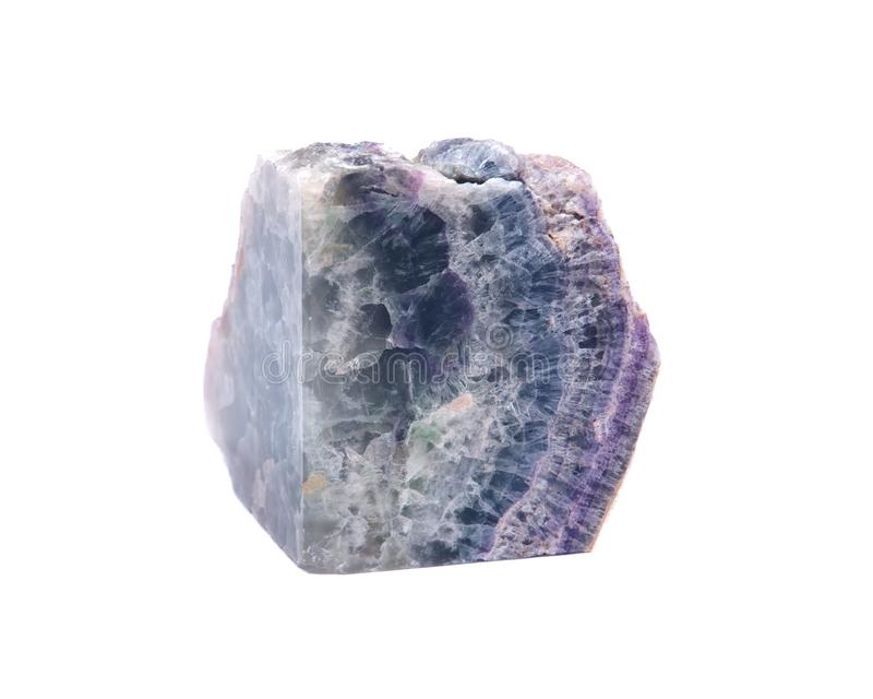 Partially polished rainbow fluorite with a naturally rough edge stock image