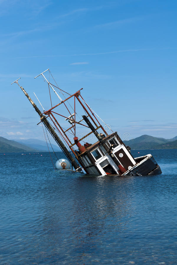Partially submerged fishing vessel in Loch Linnie. A foundered and partially submerged fishing vessel or samon farm support vessel in Loch Linnie just north of stock photo