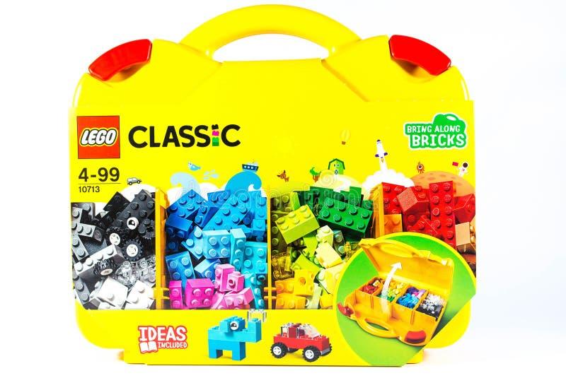 Particelle elementari classiche di Lego in cassa gialla immagini stock