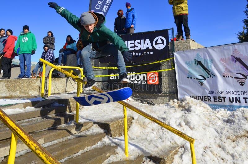 Participant au snowboarding photographie stock