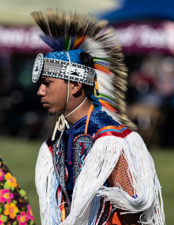 Stillwater Pow Wow Dancer. Participant dancing Native American style at the Stillwater Pow Wow in Anderson, California royalty free stock image