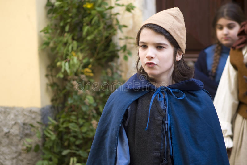 Participant of medieval costume party. Taggia, Italy – March 1, 2015: Participant of medieval costume party. For over 30 years, in the historic city of stock image