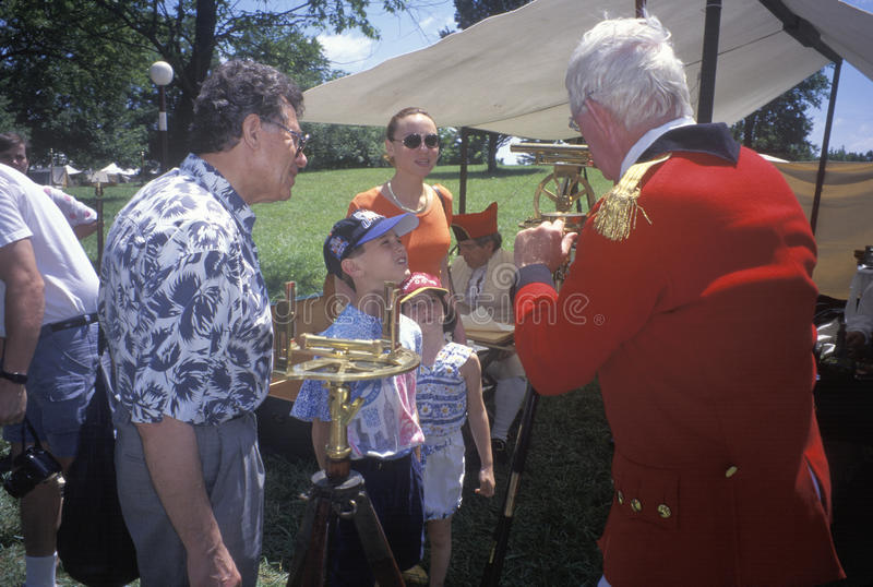 Participant with students during Historic Revolutionary War reenactment of Battle of Monmouth, Freehold, NJ royalty free stock image