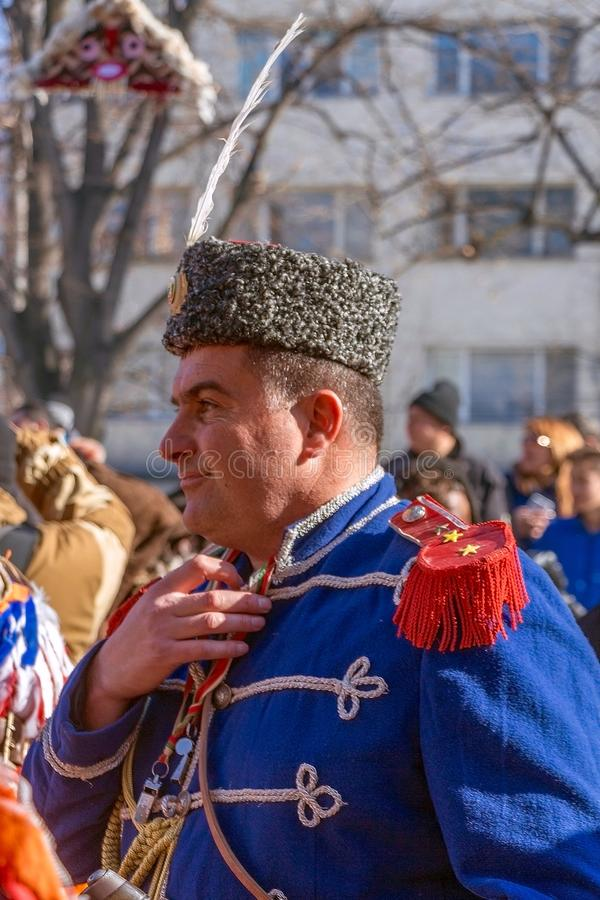 Participant in Surva Festival in Pernik, Bulgaria. Proud participant wearing old revolutionary uniform with embroiderey medals and cap in International Festival