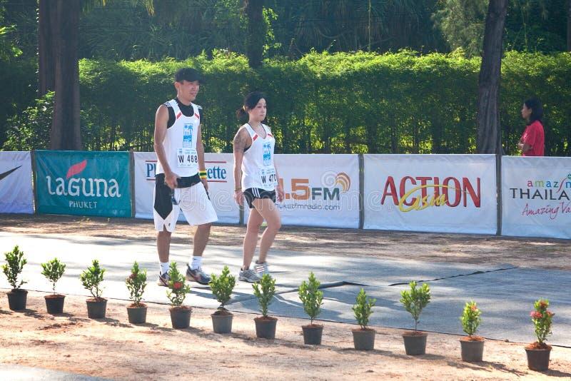 Participantes que terminam os 21km imagens de stock