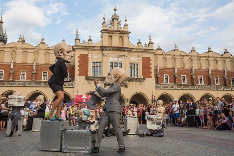 Participants at the annually (Jul 9-12) 28th International Festival of Street Theatres. KRAKOW, POLAND - JUL 12, 2015: Participants at the annually (Jul 9-12) royalty free stock photos