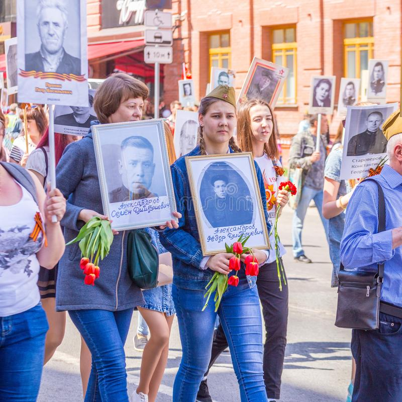 Participants in the column `Immortal Regiment` with portraits of relatives killed in World War II. Russia, Samara, May 2018: Participants in the column `Immortal stock image