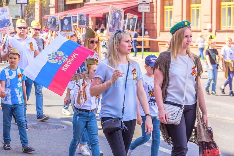 Participants in the column `Immortal Regiment` with portraits of relatives killed in World War II. Russia, Samara, May 2018: Participants in the column `Immortal stock photos