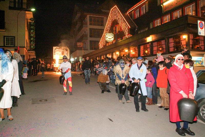 Participants in costumes perform a street procession at the carnival. Engelberg, Switzerland - 17 Febrauary 2007: Participants in costumes perform a street stock images