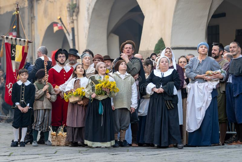 Historical re-enactment participants. Participants of historical reenactment in the old town of Taggia, in Liguria region of Italy. The actors acting out royalty free stock photos