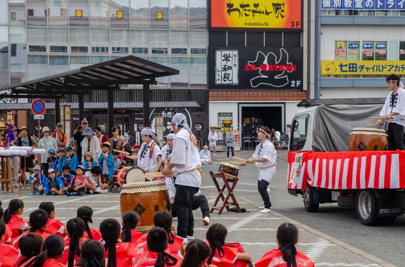 Participants of Japanese taiko drums outdoor show in small town stock photo