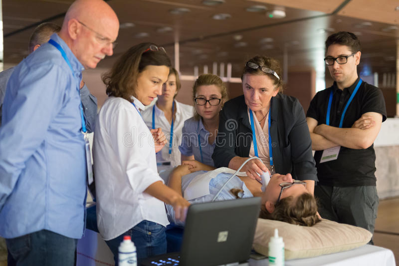 Participants learning new ultrasound techniques on medical congress. Ljubljana, Slovenia - Sept 7: Participants learning new techniques, approaches and use of royalty free stock photography