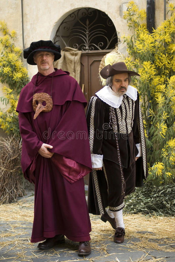 Participants of medieval costume party royalty free stock photo