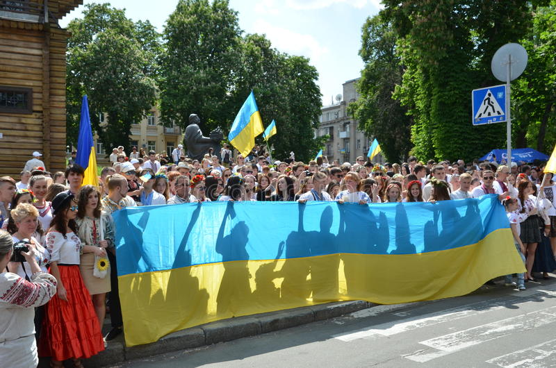 Participants of Megamarch of embroideries in Kiev. Kiev, Ukraine - May 24 2015: Ukrainian people in traditional garments take part at Megamarch of embroideries royalty free stock photography