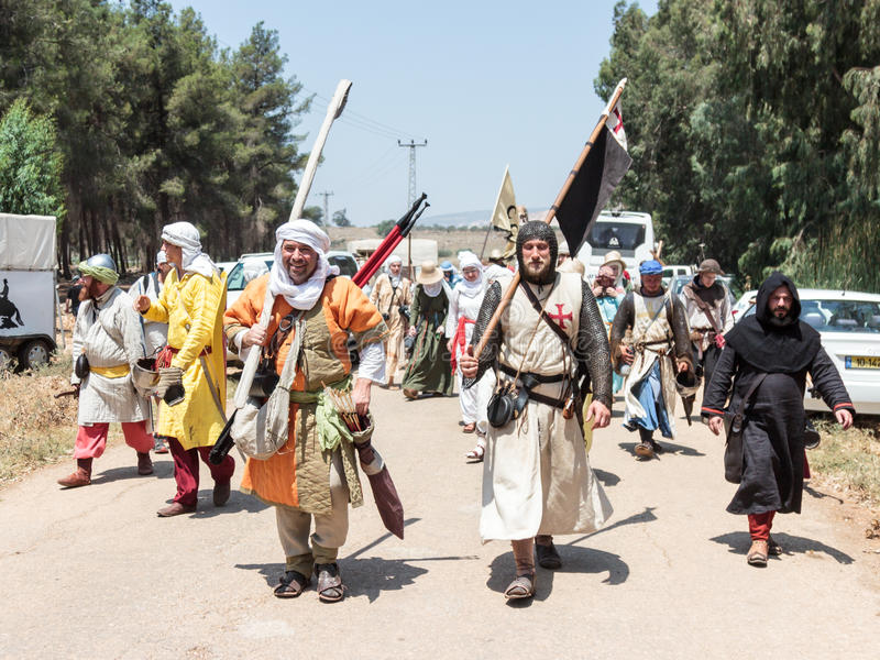 Participants in the reconstruction of Horns of Hattin battle in 1187 left the camp on foot and go to the battle site near TIberias stock images