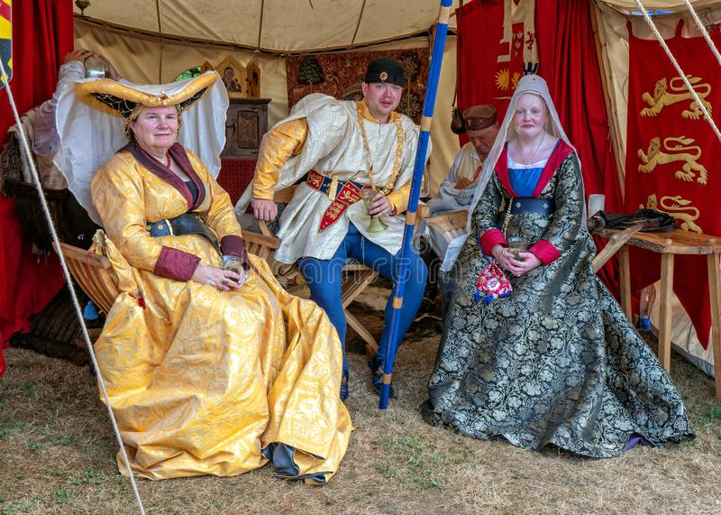 Medieval Lord and Ladies, Tewkesbury Medieval Festival, England. Participants at the Tewkesbury Medieval Festival in Gloucestershire, England dressed in period royalty free stock photo