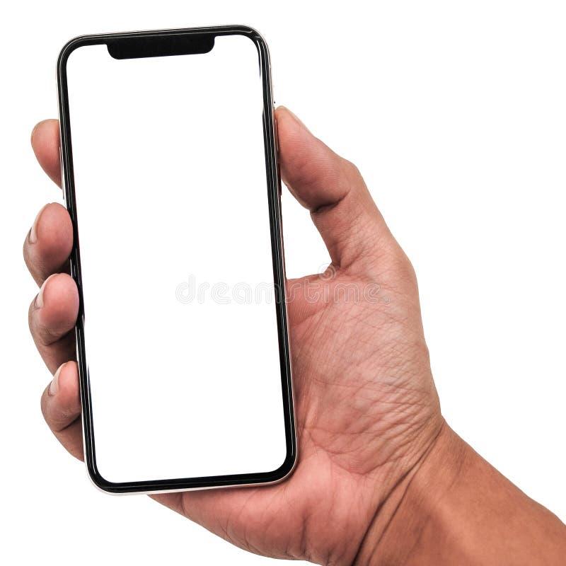 Participation de main, nouvelle version du smartphone mince noir semblable à l'iphone X image libre de droits