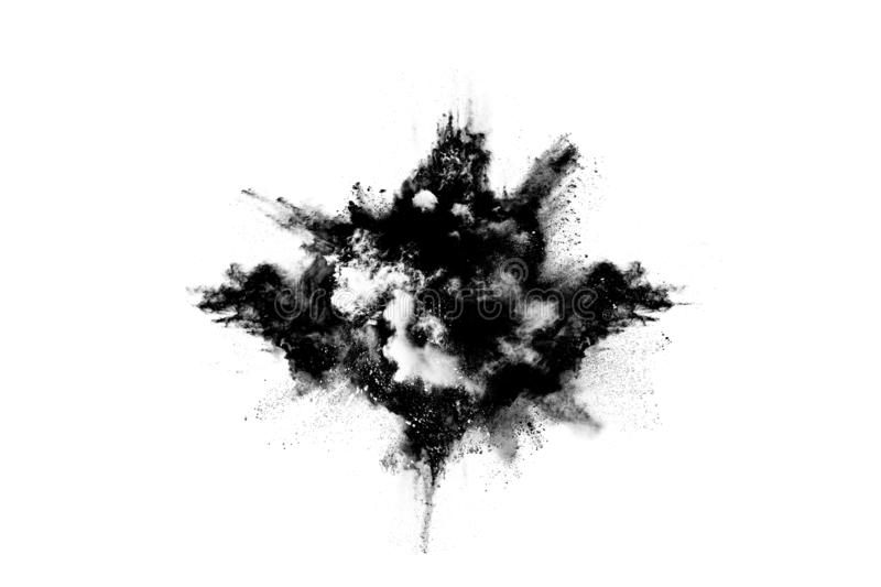 Particles of charcoal on white background. Abstract powder splatted on white background,Freeze motion of black powder exploding or throwing black powder royalty free stock photos