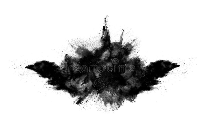 Particles of charcoal on white background. Abstract powder splatted on white background,Freeze motion of black powder exploding or throwing black powder stock image