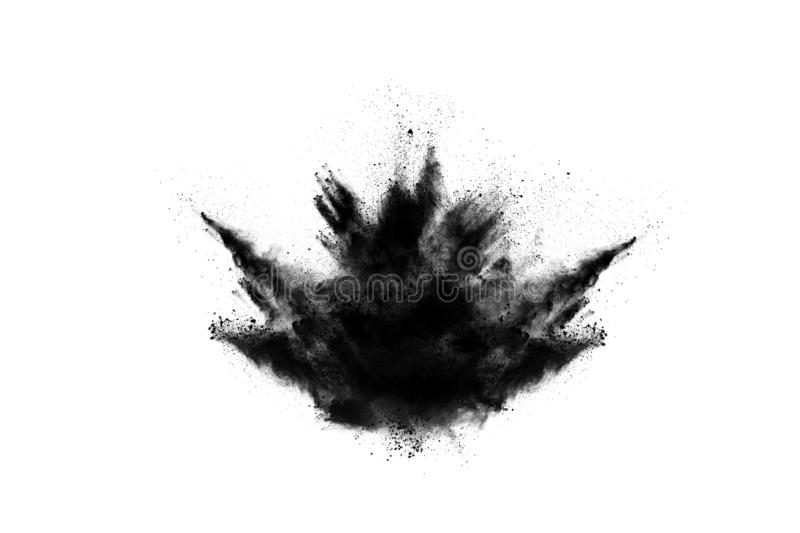 Particles of charcoal on white background. Abstract powder splatted on white background,Freeze motion of black powder exploding or throwing black powder stock photos