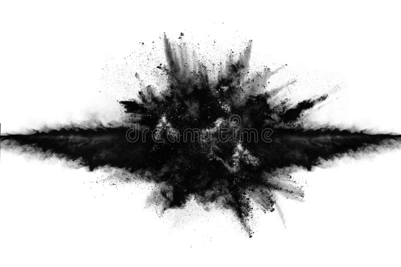 Particles of charcoal on white background. Abstract powder splatted on white background,Freeze motion of black powder exploding or throwing black powder stock images