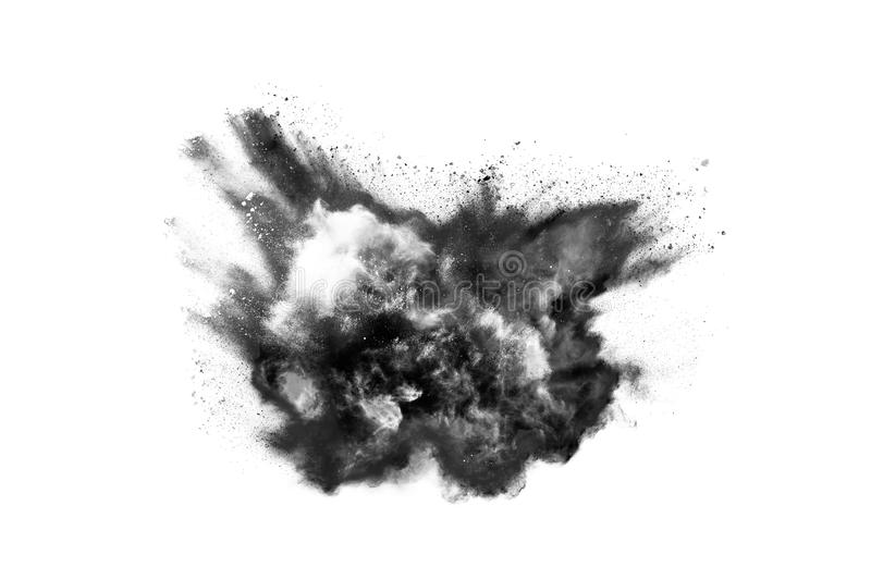 Particles of charcoal on white background. Abstract powder splatted on white background,Freeze motion of black powder exploding or throwing black powder royalty free stock photography