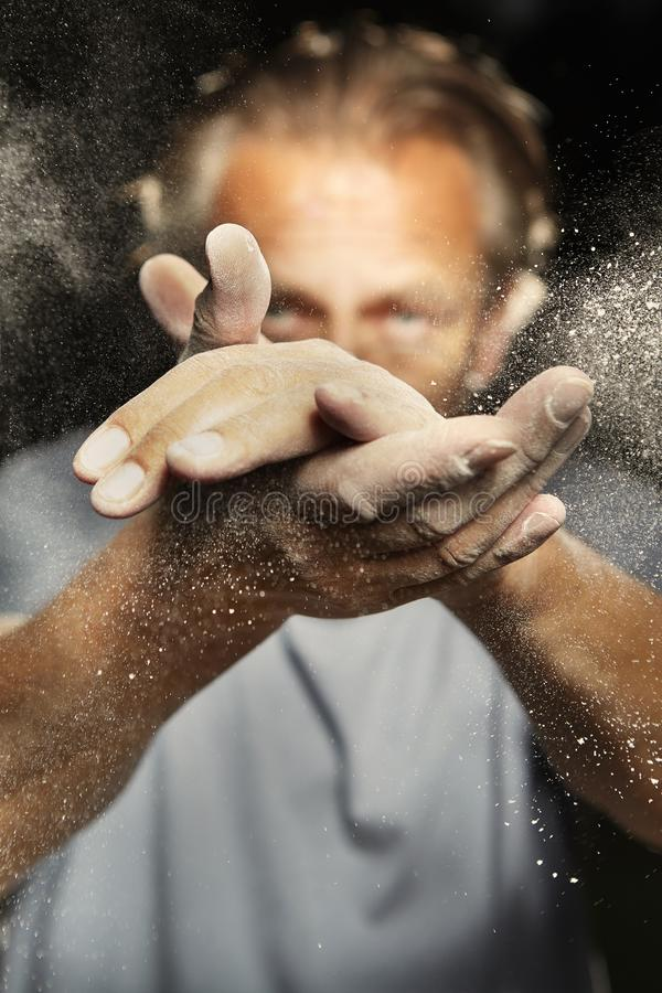 Particles of dust, dirt and flour moving fast after hands clapping stock photography