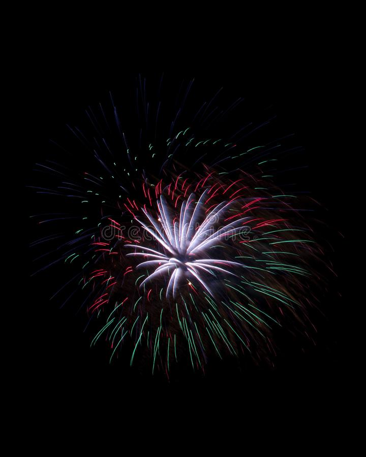 Particles of fireworks explosion isolated on black royalty free stock photography