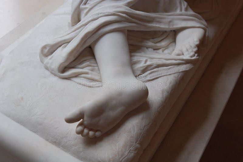 Particolare del piede della statua fotografia stock