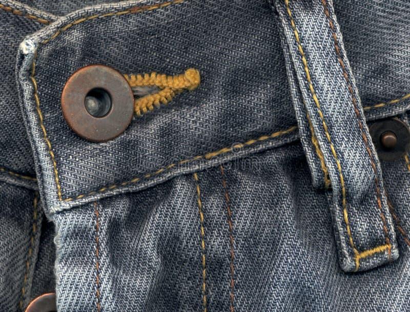 Particolare estremo dei jeans fotografie stock