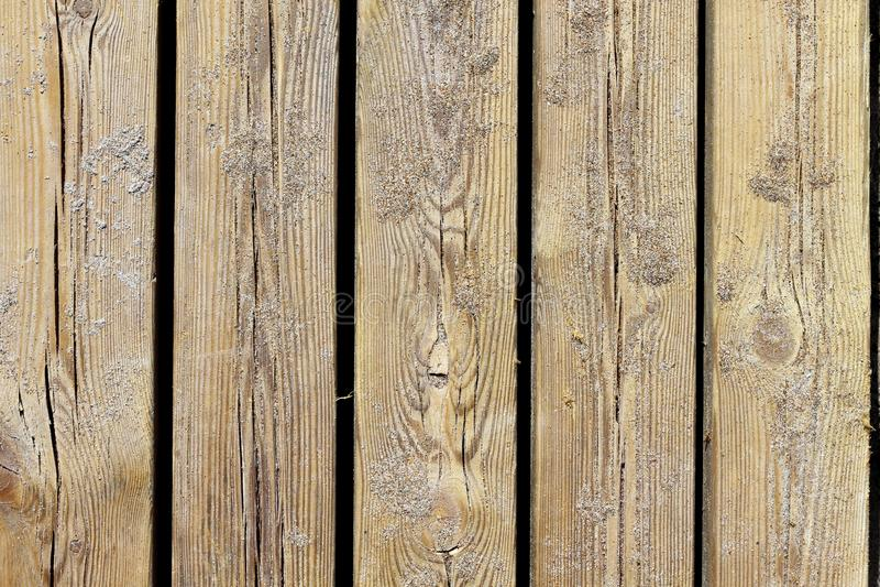 Particolare a macroistruzione invecchiato di struttura di legno della spiaggia con la sabbia immagini stock libere da diritti