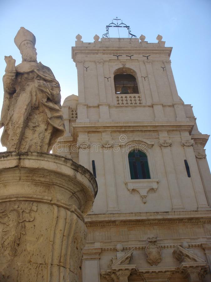 Particular of the mother church of St. Nicolò to Avola in Sicily with in the foreground the statue of a Saint. Italy royalty free stock photography