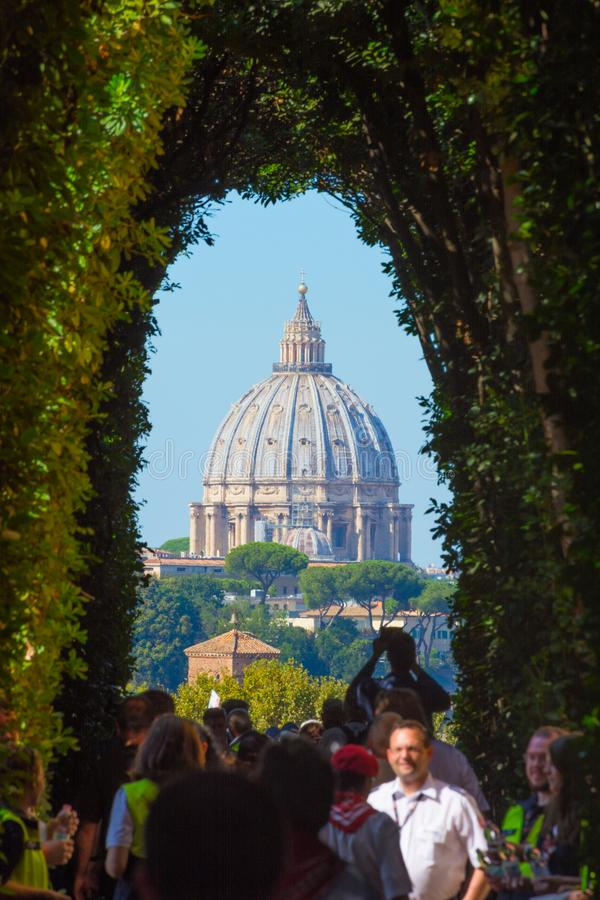 A particular view of the dome of St. Peter . At Piazza Cavalieri di Malta there is the Villa del Priorato of Malta. Rome, Italy - Oct 03, 2018: A particular view royalty free stock photo