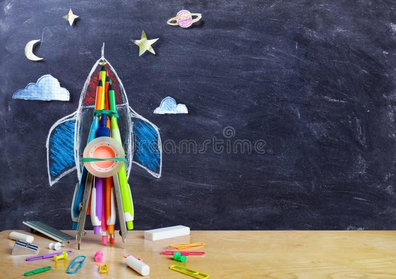 Partida - Rocket Drawing With School Supplies foto de stock