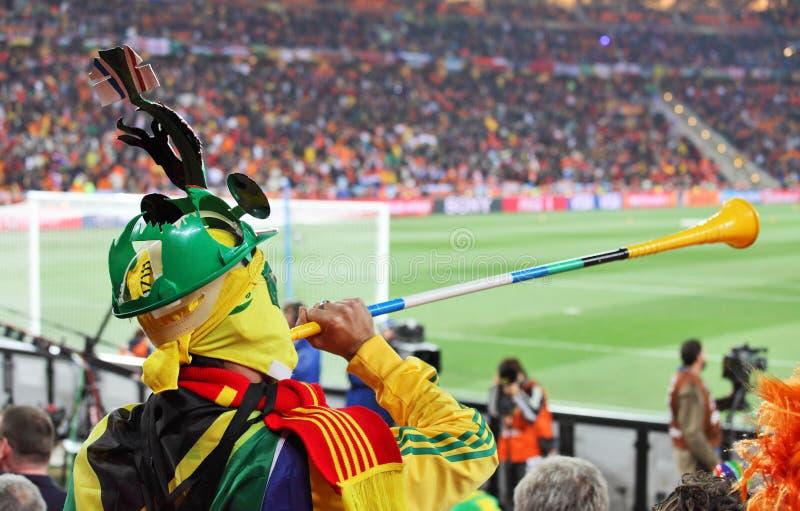 Partidario español con vuvuzela imágenes de archivo libres de regalías
