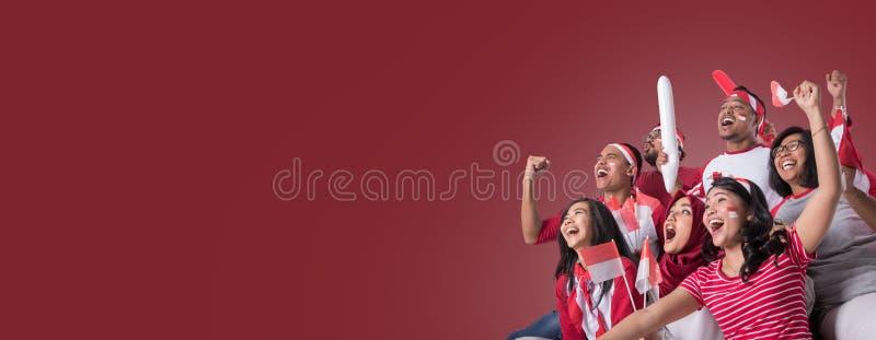 Partidario indonesio que mira con el entusiasmo imagen de archivo