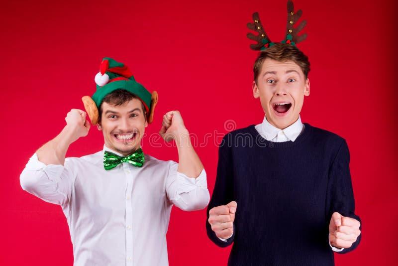 Partido dos amigos do ano novo e do Feliz Natal imagem de stock royalty free