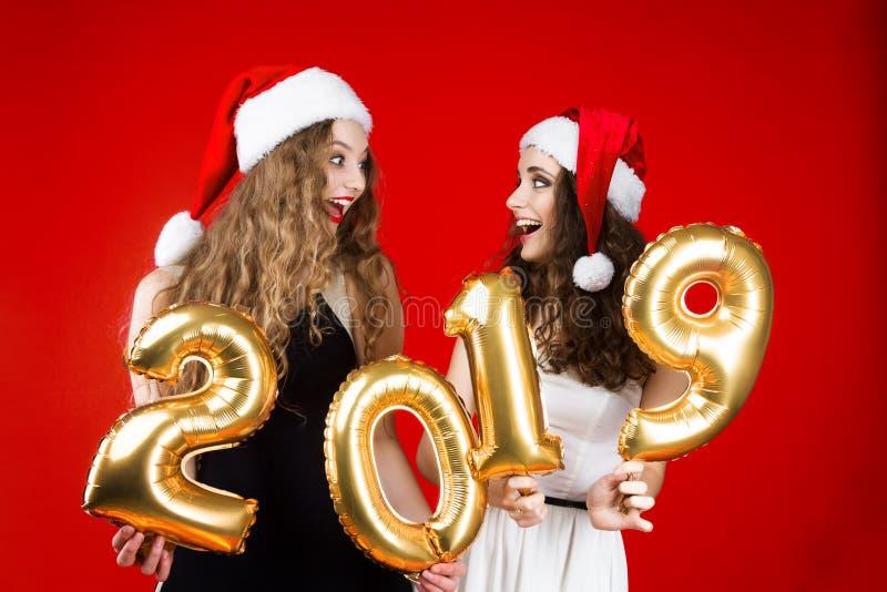 Partido dos amigos do ano novo e do Feliz Natal imagens de stock