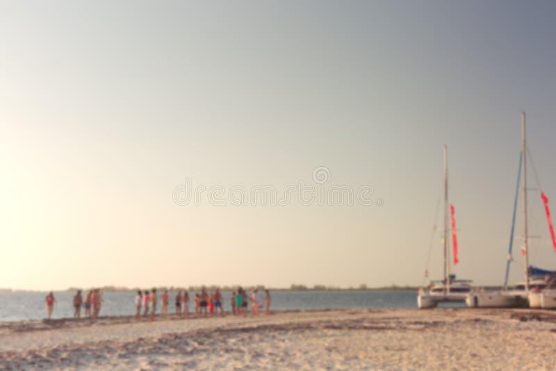 Partido na praia Fundo abstrato do borrão com bokeh imagem de stock
