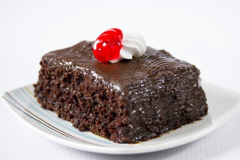 Partie délicieuse de gâteau de chocolat photographie stock libre de droits
