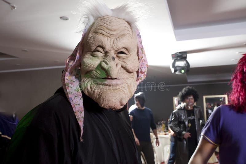 Partie d'entreprise de Halloween - les gens sont masqués image stock