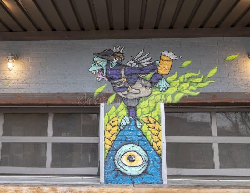 Partie de peinture murale sur le mur extérieur d'un restaurant, Ellum profond, Dallas, le Texas photos stock